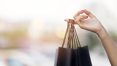 A woman holding a shopping bag