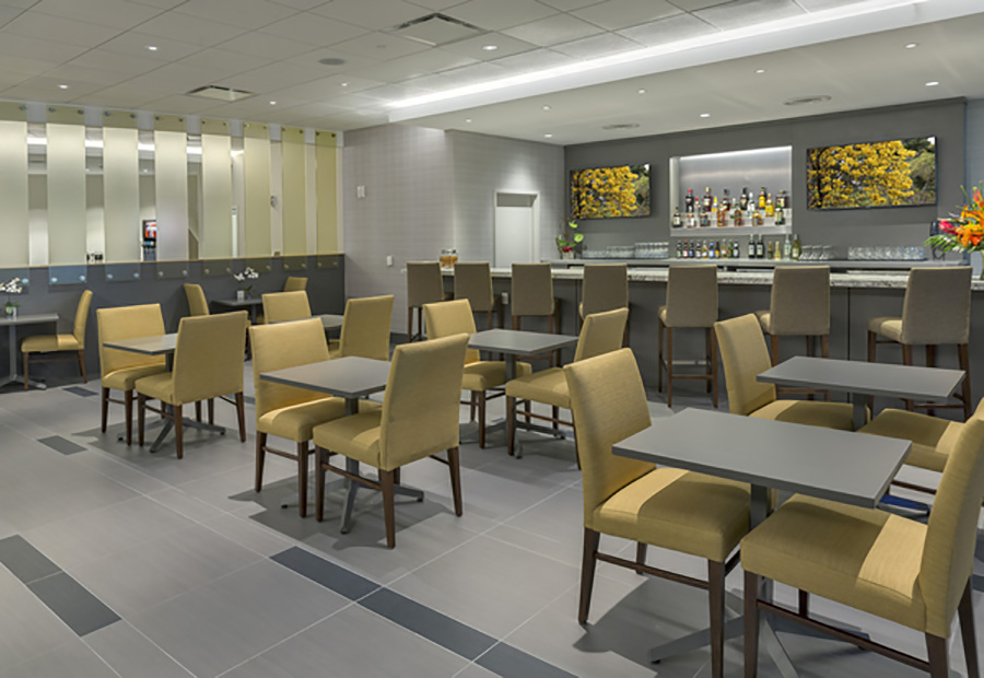 The seating arrangements in the bar area at The Club MCO, Orlando