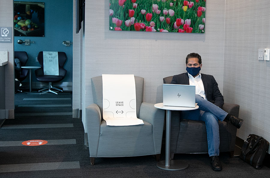 A man with a mask in the lounge